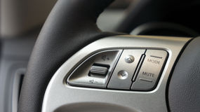 Close up steering wheel of a car. Close up of steering wheel of modern car Royalty Free Stock Photo