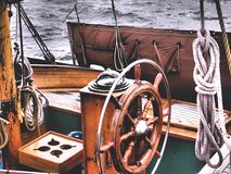 Steering wheel of a classic sailboat stock image