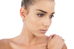 Close up of a stern woman looking away Royalty Free Stock Images