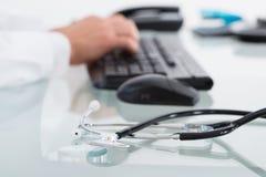 Close-up Of Stethoscope On Desk Royalty Free Stock Photo