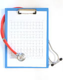 Close up of stethoscope on ecg papers Royalty Free Stock Images