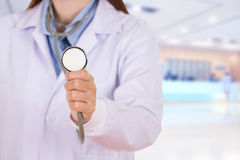Close up stethoscope with female doctor in hospital Stock Photo