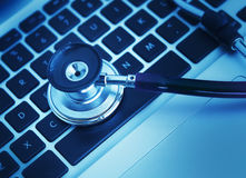 Close-up of stethoscope on laptop keyboard Royalty Free Stock Photo