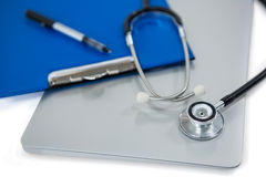 Close-up of stethoscope on laptop Stock Photography