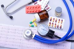 Close-up stethoscope lying on RX prescription with assorted pills. Healthy life or insurance concept. Close-up stethoscope lying on RX prescription with Stock Photo