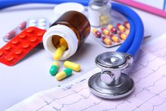 Close-up stethoscope lying on RX prescription with assorted pills. Healthy life or insurance concept. Close-up stethoscope lying on RX prescription with royalty free stock photos
