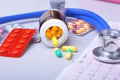 Close-up stethoscope lying on RX prescription with assorted pills. Healthy life or insurance concept. Close-up stethoscope lying on RX prescription with Royalty Free Stock Images