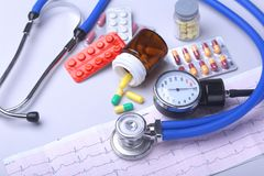 Close-up stethoscope lying on RX prescription with assorted pills. Healthy life or insurance concept. Close-up stethoscope lying on RX prescription with Stock Photos