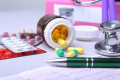 Close-up stethoscope lying on RX prescription with assorted pills. Healthy life or insurance concept. Close-up stethoscope lying on RX prescription with stock image