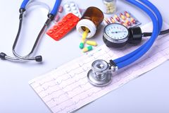 Close-up stethoscope lying on RX prescription with assorted pills. Healthy life or insurance concept. Close-up stethoscope lying on RX prescription with stock photography