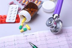 Close-up stethoscope lying on RX prescription with assorted pills. Healthy life or insurance concept. Close-up stethoscope lying on RX prescription with royalty free stock photography