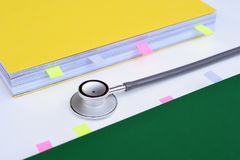 Close up of stethoscope with notebook Royalty Free Stock Images