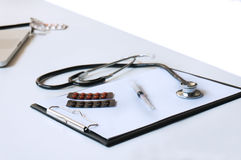 Close-up of stethoscope and paper on white table Stock Images