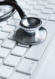 Close up of stethoscope on pc keyboard Stock Photo