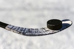 Close-up of sticks and pucks in the stadium. Close-up stick and puck on the ice background Stock Photo
