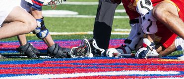 Close up of sticks and ball during lacrosse faceoff. Close up of the two sticks with the ball inbetween during the faceoff of a high school boys lacrosse game on stock photography