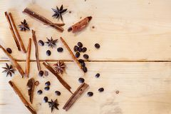 Close-up still-life coffee star anise cinnamon on background woo. Close-up still-life of cinnamon, star anise and coffe on magic christmas holiday on background stock photos