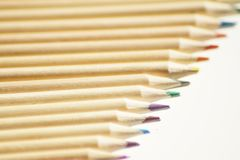 Close up on colored wooden pencils royalty free stock photography