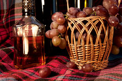 Close-up still life made by the wine, cognac and grapes in the b Stock Photography