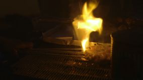 Roasting of meat on sticks, Conakry, Guinea. Close up, still shot, pieces of fresh meat being roasted, arranged on top of fire grill using sticks, end sides stock footage