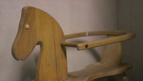 Trojan horse, rocking Toy seat, Africa Mercy. Close up still shot, sturdy, smooth light-vanished, wooden rocking Trojan horse, baby`s toy, seat, holding rod stock video footage