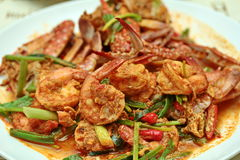 Close up of stir-fried  crab and shrimp in curry powder is top-ten of popular Thai food. Selective fous. Royalty Free Stock Photo