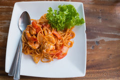 Close up stir fried spaghetti and prawn with tomato sauce. Stock Photo