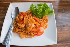 Close up stir fried spaghetti and prawn with tomato sauce. Royalty Free Stock Photo