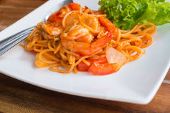 Close up stir fried spaghetti and prawn with tomato sauce. Stock Photography