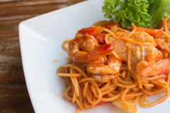 Close up stir fried spaghetti and prawn with tomato sauce. Royalty Free Stock Photography