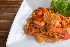 Close up stir fried spaghetti and prawn with tomato sauce. Stock Image