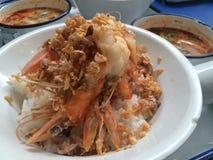 Close up stir fry garlic pepper prawn with  mushroom Tomyum soup Royalty Free Stock Photos