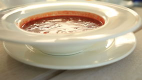 Close-up of stirring up sour cream in borsch served in cafe or restaurant stock video
