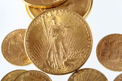 Lot of Gold coins for saving. Close up of a stock of Gold french and american coins royalty free stock photos