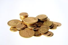 Lot of Gold coins for saving. Close up of a stock of Gold french and american coins royalty free stock photography