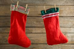 Close up of stockings hanging on rope. Against wooden wall Stock Photography