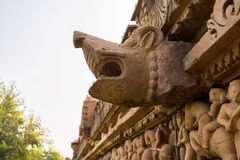 Stone animal head carved in Lakshman Temple close. Close up stone animal head on wall of Lakshmana Temple, Khajuraho, India. Unesco World Heritage Site. The most Stock Images