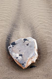 Close-up of a stone on the beach of Lanzarote. Close-up of a stone on the beach Royalty Free Stock Photography