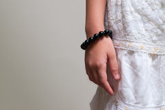 Close up stone bead bracelet on girl hand