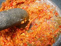 Close up of a stone bowl of sambal Royalty Free Stock Photo
