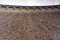 Close up on stone dam wall Stock Image