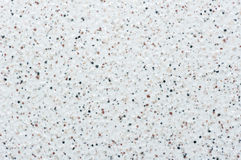 Close-up of a stone floor forming the background. White stone floor with an uneven texture of stones Stock Image