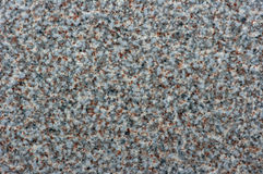 Close-up of a stone floor forming the background. Royalty Free Stock Photo