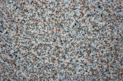 Close-up of a stone floor forming the background. An uneven stone floor texture of stones Stock Photography