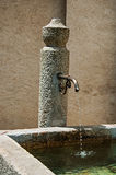Close up of stone fountain in Megève. Stock Images