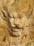 A close up of a stone Grotesque carved face royalty free stock images