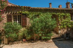 Close-up of stone house facade with bindweed in an alley at Les Arcs-sur-Argens, Royalty Free Stock Image
