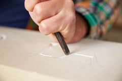 Close Up Of Stone Mason At Work On Carving In Studio Royalty Free Stock Photography