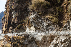 Close up stone mountain with road in winter near the way to Tsomgo Lake in Gangtok. Sikkim, India Royalty Free Stock Images