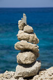 Close-up of stone stack against blue sea Royalty Free Stock Photography